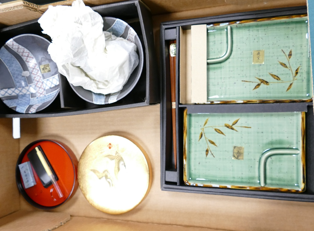 A collection of modern Japanese boxed items to include: rice bowls, ink blocks,