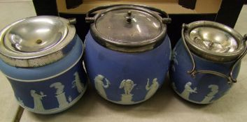 A collection of Wedgwood jasper ware: to include two biscuit barrels ( 1 chip to base rim) and a
