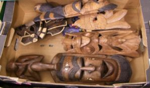 A mixed collection of items to include : African and Indonesian carved wood masks