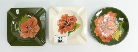 Moorcroft Hibiscus coaster: (boxed) together with two Hibiscus ashtrays.