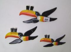A set of three Carlton ware Guinness toucan wall plaques: