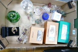 A mixed collection of items to include: boxed glass paperweights, decorative glass items etc