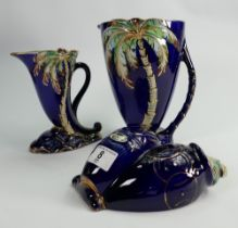 A collection of Beswick dark blue Palm Jugs: and wallplaque. (3)