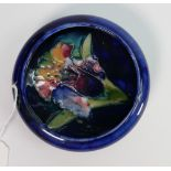 Moorcroft trinket dish in the Orchid pattern: 11cm diameter. Impressed and signed in blue. Potters