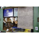 A mixed collection of items to include: boxed Tri Ang train, Pottery figures, cased cutlery etc