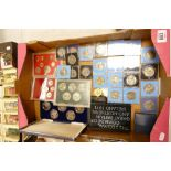 A large collection of Commemorative Crowns: decimal coin sets, Carrs of London boxed set etc