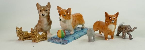 A collection of Royal Doulton, Beswick & Wade Corgi Dog Figures(7):