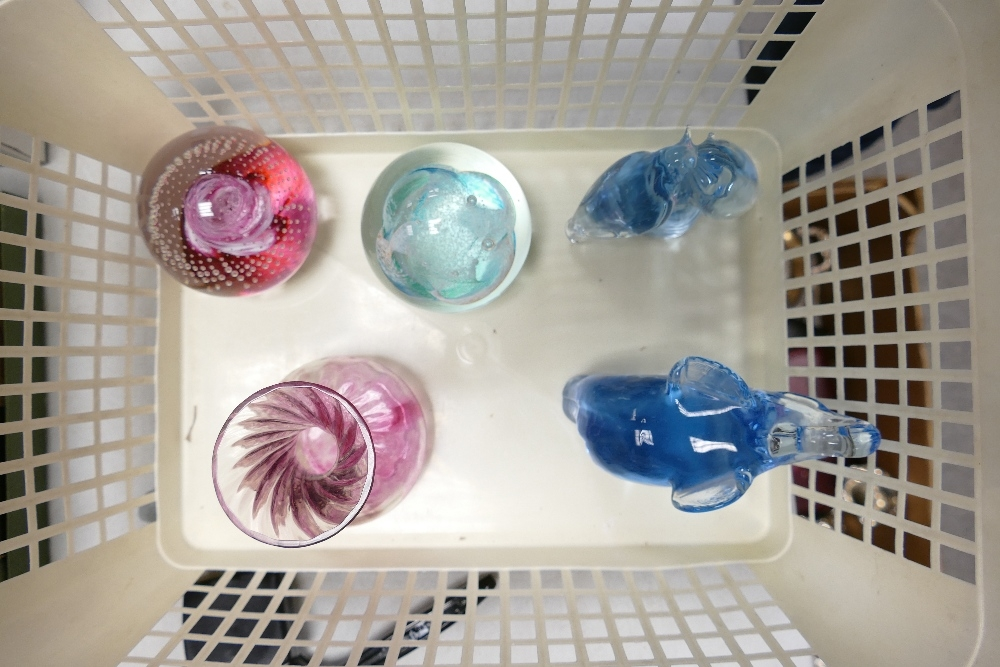 Two Caithness paperweights: together with two similar animal paperweights and a small vase