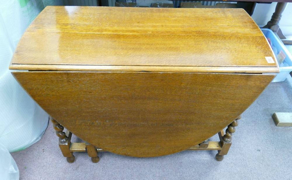 Large oak barley twist gateleg dining table: Circa 1930's - 30's, measuring 164 cm x 106 cm x 72