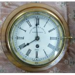 Brass cased Ships Bulkhead Clock by Henry Browne & Sons: mounted, diameter of dial 14.5cm