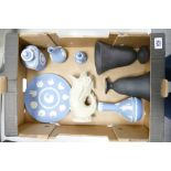 A collection of Wedgwood items to include: un finished black basalt vases, light blue vases &