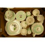 A collection of Wedgwood Hampton Court patterned teaware: nip noted to lip of spout of teapot, 22