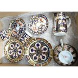 Royal Crown Derby cups and saucers plus cream jug: One tea cup and two coffee cups all with saucers,