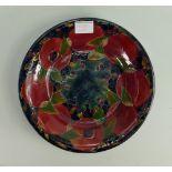 William Moorcroft Burslem large dish :decorated in the pomegranate design, d28cm. (broken into 4