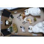 A mixed collection of items to include: Beswick dogs, Wade whimsies, etc