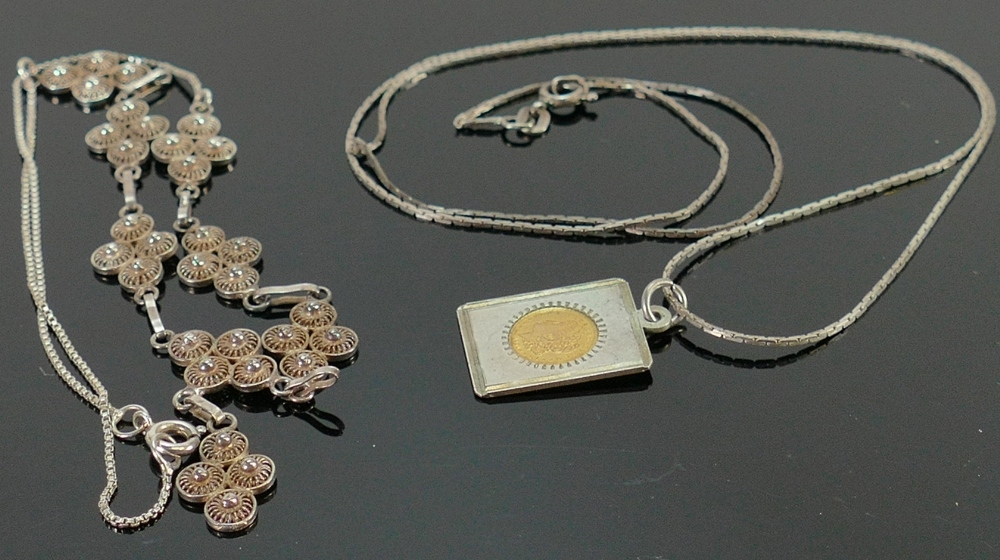Silver necklace, pendant and ornate white metal necklace: (3)