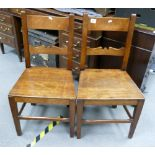 Two mid 19th century country made dining chairs: Fruitwood or similar.