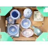 A collection of Wedgwood items to include: Teal Vase, Lilac pin tray, blue lidded boxes & pin