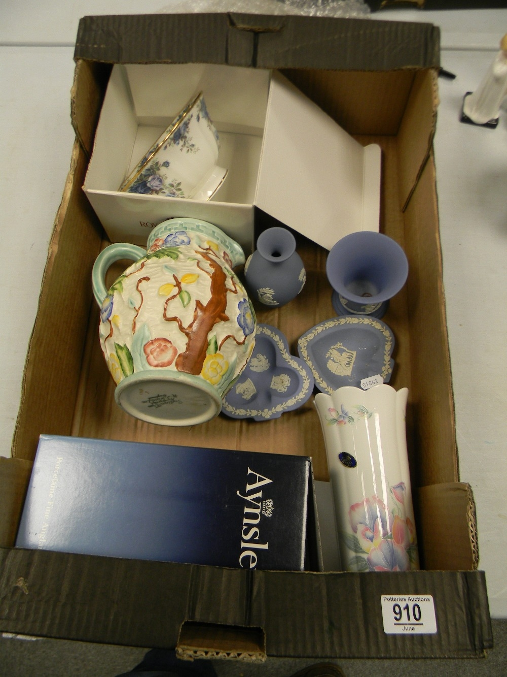 A mixed collection of items to include: boxed Royal Albert Moonlight Rose Footed Bowl, Wood Indian