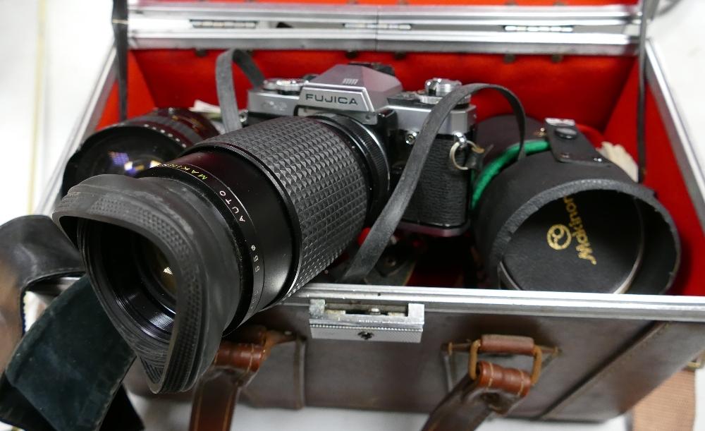 Cased Fujica AX-5 Film Camera: with Makinon 28-80 zoom lens( hood dented), Makinon 80-200 lens, Tele