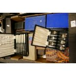 A large collection of boxed antique cutlery sets: