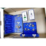 A mixed collection of items to include: cased nautical theme key rings, glass & chrome bottle