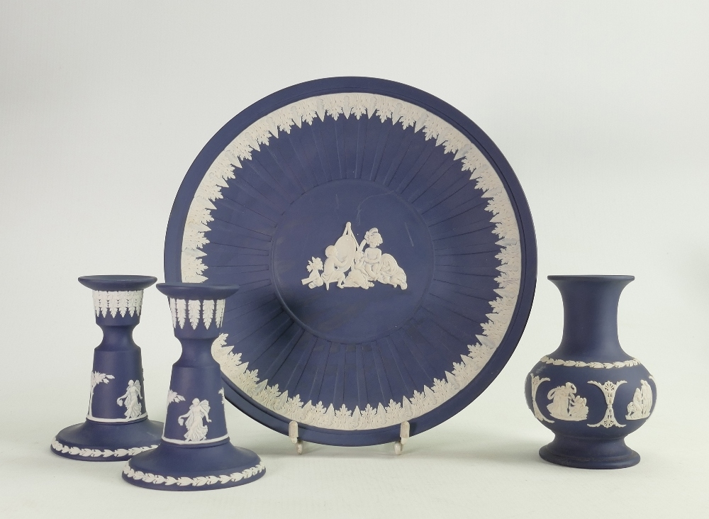 A Collection of Wedgwood Queens Blue items to include: dancing hours candlesticks, vase & wall plate