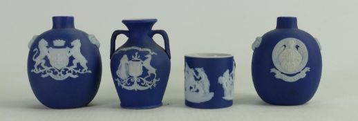 A collection of Wedgwood dip blue miniature items to include: Crested vases & tankard.