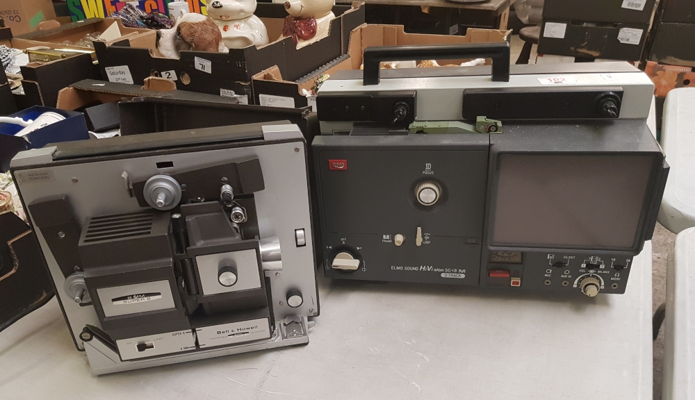 A Bell & Howell super 8 projector: together with a Elmo Sound Hi Vision SC-18M 2 track machine.