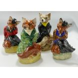 Set of Four Staffordshire Pottery Foxes: all in sample colour ways, height of tallest 20cm(4)