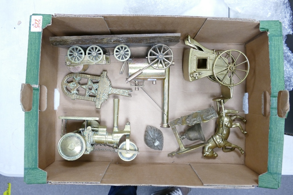 A collection of heavy brass ornaments to include: steam engines, horse & carriage, ornamental bell