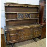 Early 20th Century oak linen fold buffet sideboard/dresser: Height 169cm x 163cm wide x 46cm deep.