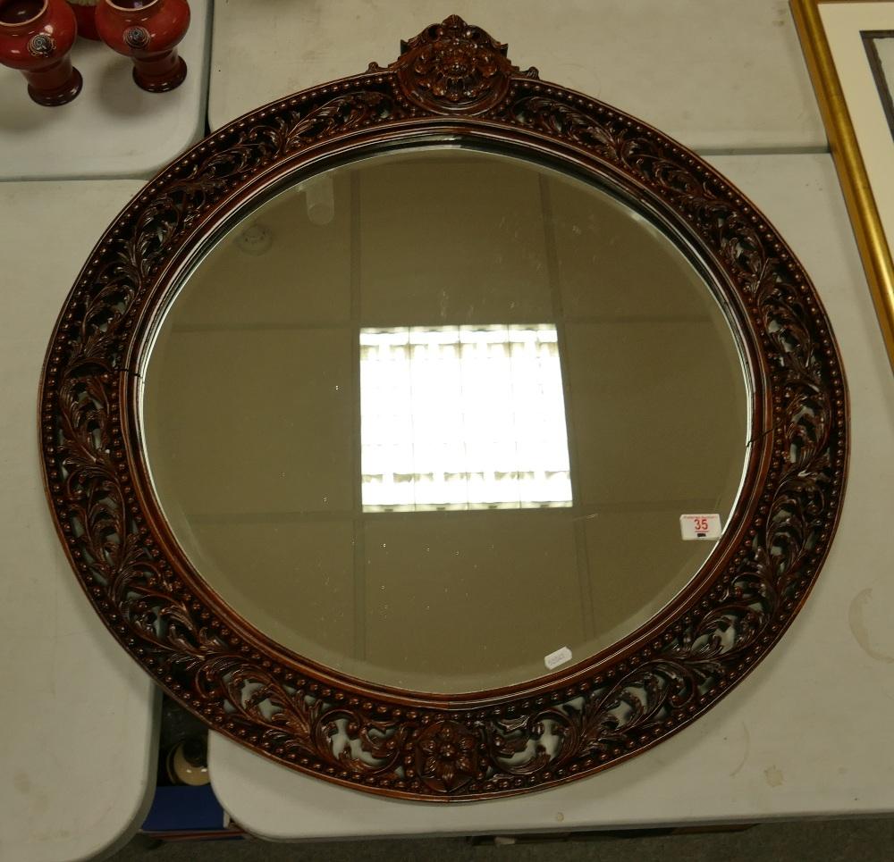 Large Dark Wood Circular Wall Mirror: diameter 84cm, (splits noted)