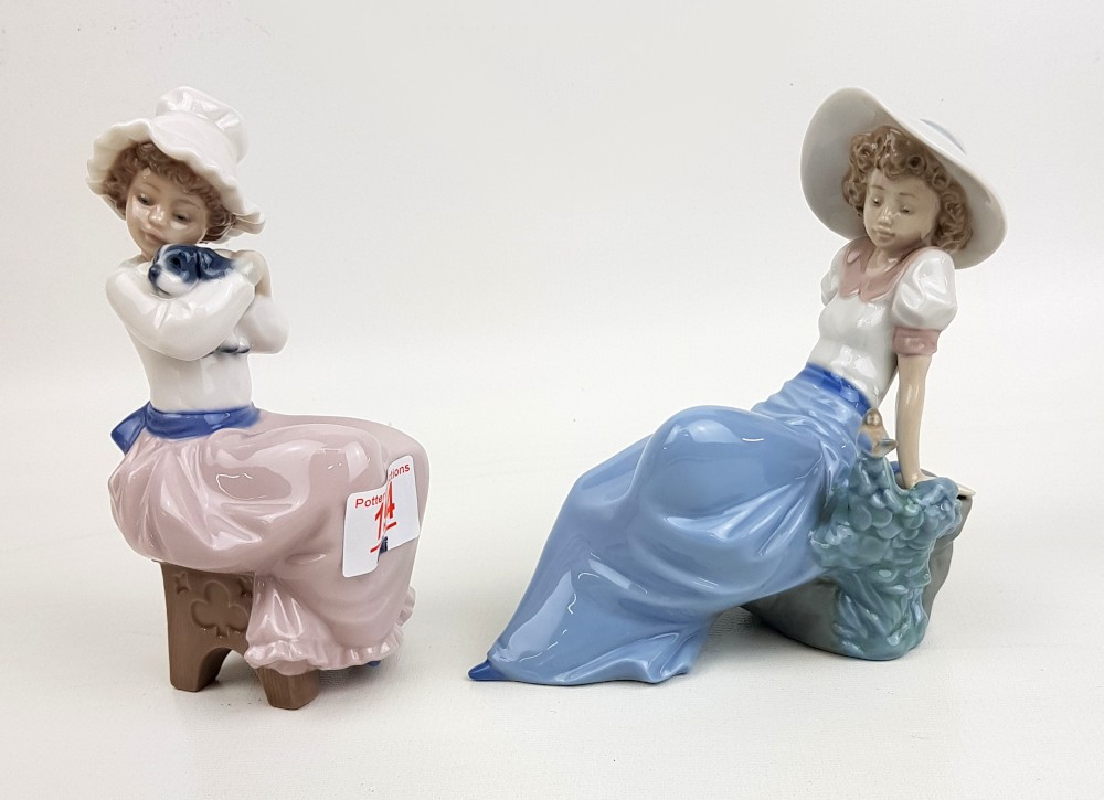 Two Nao figurines: seated girl with puppy & reclining girl with garden bird (2).
