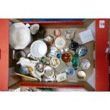 A mixed collection of items to include: glass paperweights, Halcyon Days pot, pottery figure of