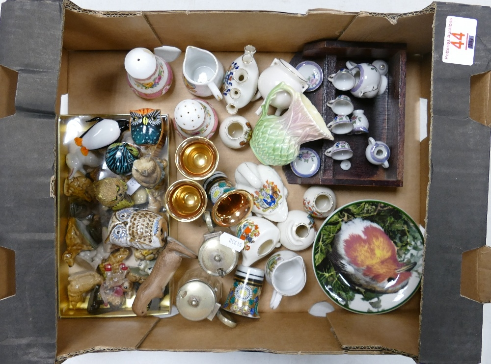 A mixed collection of items to include: miniatures, Wade whimsies, crested china, novelty figures