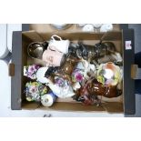 A mixed collection of items to include: ceramic horses, floral tea ware, ceramic flowers etc
