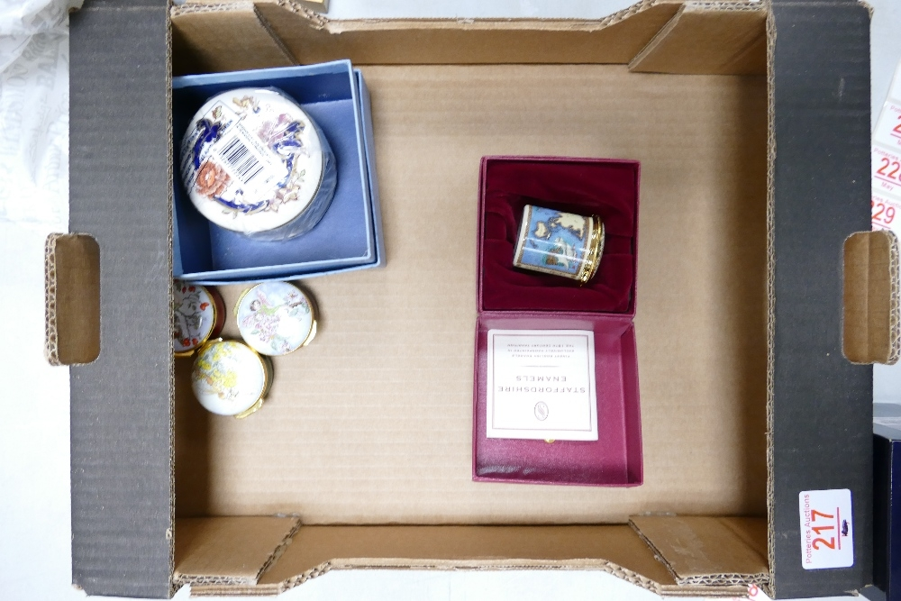 A collection of Enameled & Pottery Boxes to include: Royal Doulton Specially commissioned items,