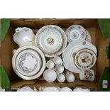A collection of floral gilt decorated dinner & tea ware: