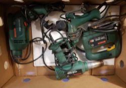 Mixed Bosch power tools: jigsaw, heat gun, hammer drill and a hot glue gun.
