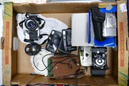 A collection of camera equipment to include: Praktica MTL3 ( zeiss lens fitted) , Kersaw Eight 20