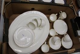 A collection of Wedgwood Aurora coffee ware items: 11 cups, 9 side plates, 16 saucers together