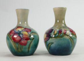Pair of Walter Moorcroft Freesia vases on green blue ground: Height 12cm. (2)