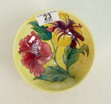 Moorcroft Hibiscus footed bowl: on yellow. 13.5cm diameter