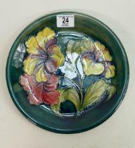 Moorcroft Hibiscus charger: on green. 26cm diameter