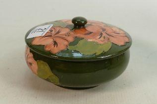 Moorcroft Hibiscus on green lidded pot: 13.5cm diameter