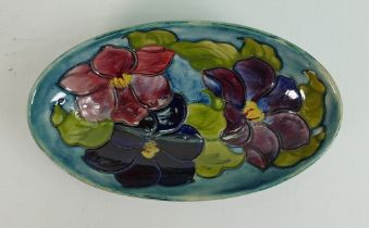 Moorcroft Clematis on blue ground oval dish: Diameter at largest 23cm, Queen Mary sticker noted.