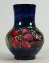 Moorcroft Anemone on fading blue ground vase: Height 12cm.