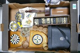 A mixed collection of items to include: cased binoculars, vintage domino's, AA car mascot badges,