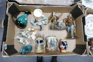 A mixed collection of items to include: German Beer Steins, Poole pottery items , novelty dog